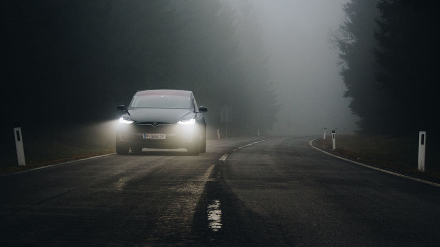 Road in foggy weather at night