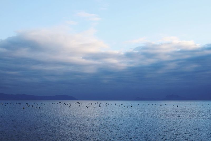 La Mer. Sky Scenics Tranquility Beauty In Nature Cloud - Sky Tranquil Scene Nature Water Sea No People Outdoors Waterfront Day Blue Sunset Italy Naples Napoli