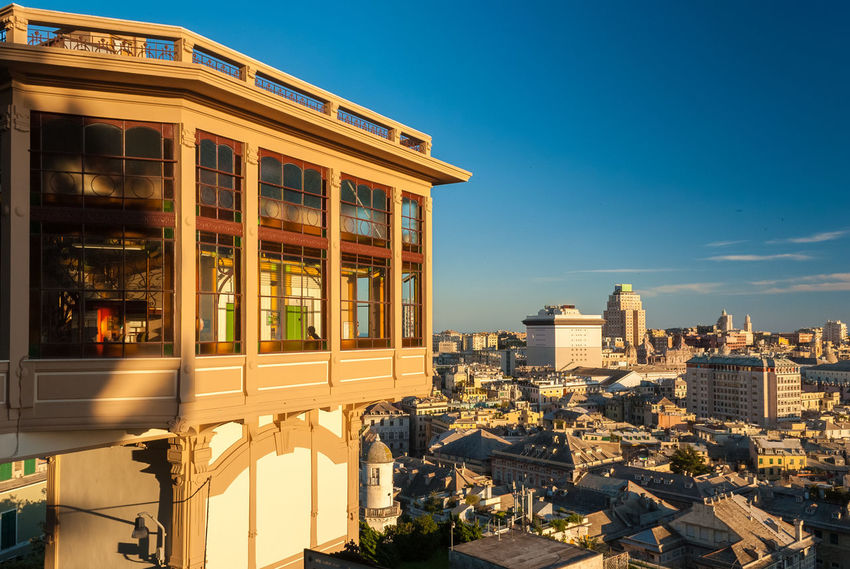 """The public elevator of """"Castelletto"""" in Genoa, with city in background Architecture Blue Buildings Castelletto City City Center Downtown Elevator Genoa Genova Golden Hour Houses Italy Liberty Lift Liguria Outdoors Panorama Sky Skyline Sunny Sunset Urban View"""