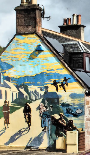 Village of Invergordon - Cromarty, Scottish Highlands Architecture Graffiti Real People City Sky Day Outdoors Bicycles Shops Stormy Sky Painted Houses Street Scenes Invergordon Building Exterior Built Structure #urbanana: The Urban Playground