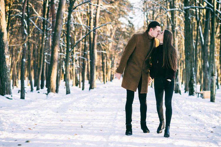 Adult Adults Only Beauty Beauty In Nature Cold Temperature Day Forest Men Nature Outdoors People Snow Togetherness Two People Warm Clothing Winter Young Adult Young Men Young Women