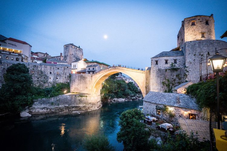 Mostar Stari Most Mostar Architecture Built Structure Building Exterior Water Connection Bridge Sky Arch Illuminated Bridge - Man Made Structure Nature History City Arch Bridge Travel Destinations