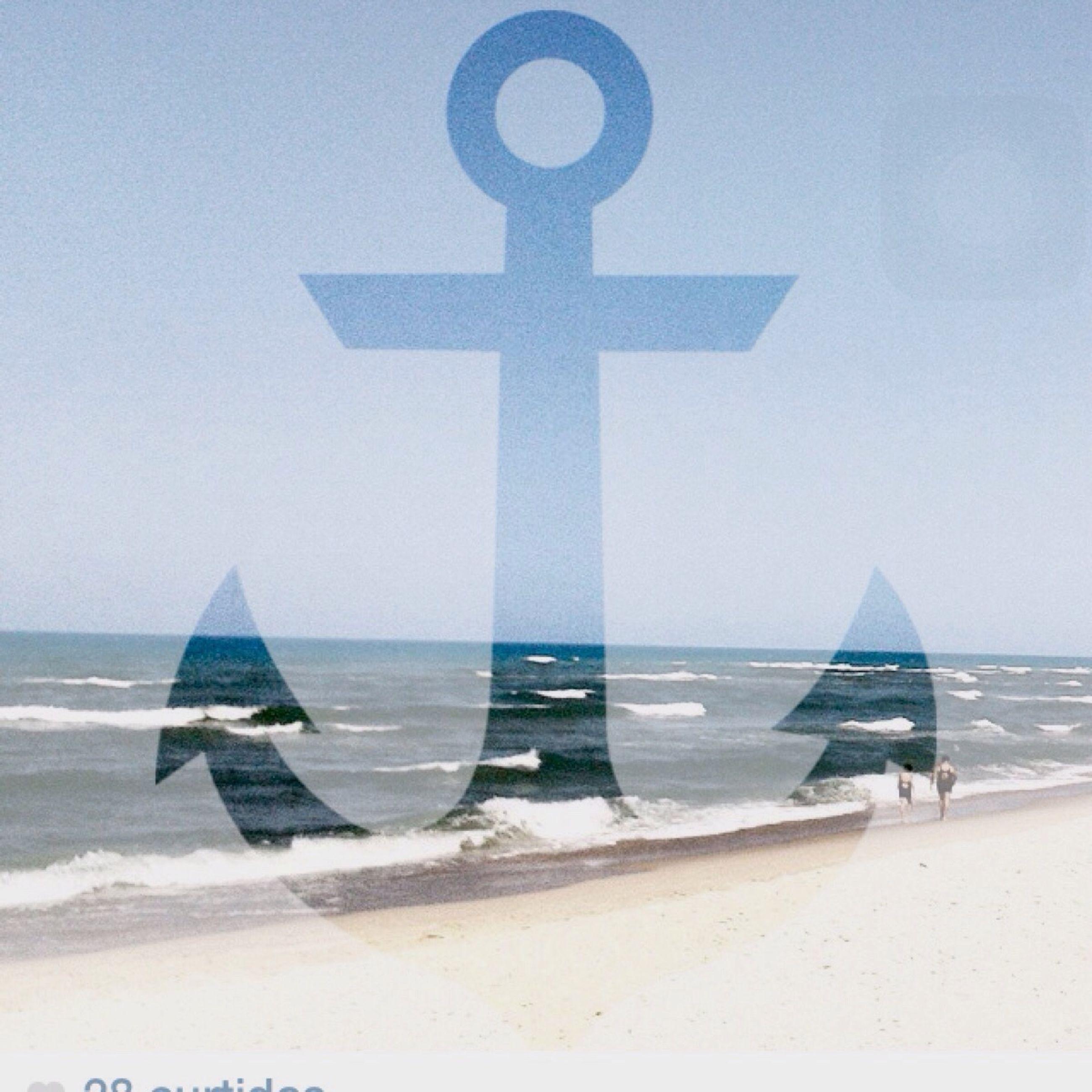 sea, water, horizon over water, beach, human representation, clear sky, art and craft, shore, religion, sculpture, art, sand, creativity, statue, sky, cross, day, spirituality, tourism