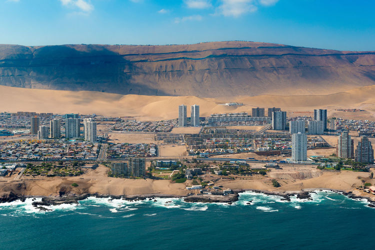 Aerial view of Iquique, a northen port in the Atacama desert in Chile Apartment Buildings Architecture Atacama Desert Chile Chilean  Coastline Desert Iquique Latin America Skyline Aerial View Architecture Building Building Exterior City Cityscape Coast Dune Latin American Northern Sand Dune Sea Water