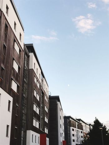 Building Exterior Architecture Built Structure Low Angle View City Window Sky Building Residential Structure Residential Building Building Story Office Building City Life Apartment Tall - High Cloud Blue Outdoors Day High Section