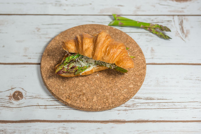 Croissant with asparagus and cream cheese on a cork board Asparagus Breakfast Cheese Circle Close-up Cork Board Cream Cheese Croissant Food And Drink Freshness Healthy Food Homemade Indoors  Lunch Photography