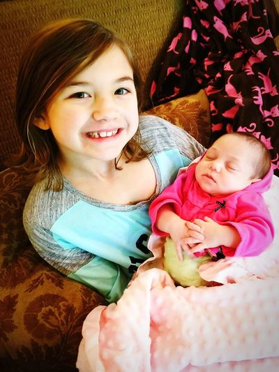 My Daughter, Josie, holding my Niece, Ammerie Proud Daddy Kid Photography Babygirl Baby ❤ Baby Pic Girls Girl Power Togetherness Cheerful Males  Family Bonds Daughter
