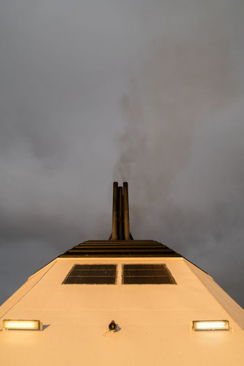 Close-up view of a chimney of a passanger ship in upright format Black Burn Chimey Close-up Cloud Copy Space Dark Directly Below Energy Ferry Journey Nautical Vessel Passenger Ship Pollution Scary Sea Sky Smog Smoke Tourist Toxic Substance Transportation Travel Vacations Water