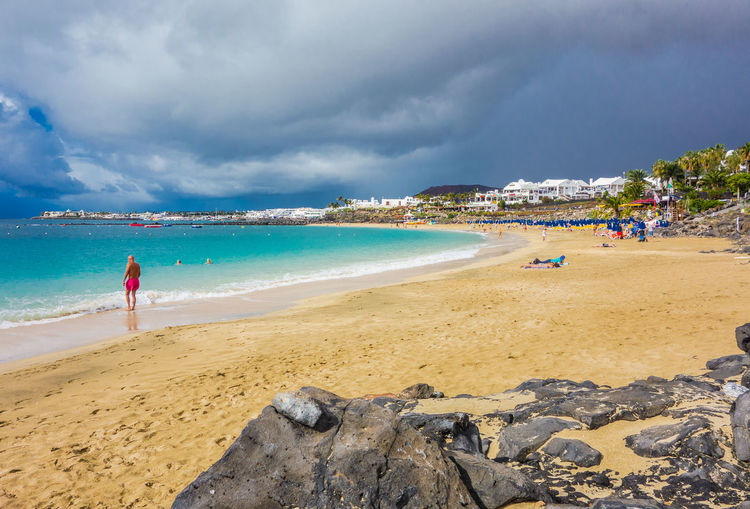 View Of Beach Against Cloudy Sky