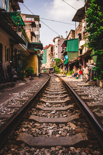 Railroad tracks going through the centre of Hanoi in Vietnam. ASIA Vietnam Architecture Building Exterior Built Structure Cable Day Hanoi No People Outdoors Rail Transportation Railroad Track Sky Transportation