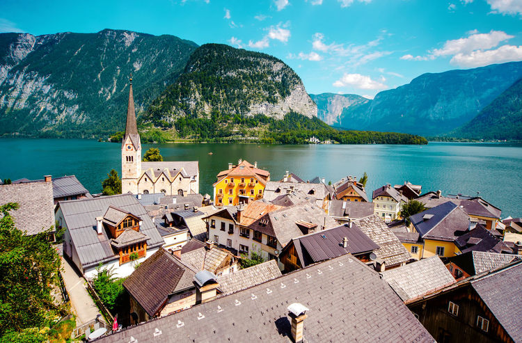 Hallstatt, picturesque village in Austria Alps Austria Ancient Architecture Austria Beauty In Nature Cloud - Sky Coastal Europe Famous Place Hallstatt Hills Houses Lake Landscape Mountains Nature Picturesque Village Range Ridge Rooftops Salzkammergut Scenery Summer Sunny Day Unesco Village