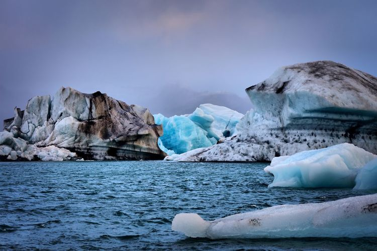 Iceland - icebergs Sea Tranquility Tranquil Scene Nature Waterfront Beauty In Nature Scenics Idyllic Iceberg Water Ice Sky Day No People Cold Temperature Outdoors Floating On Water Global Warming