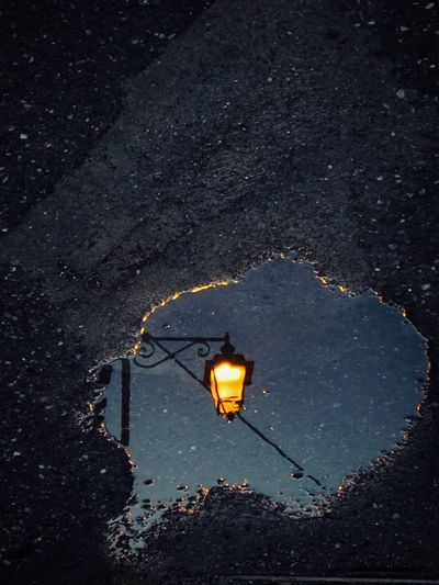 Reflection Street Lamp Streetphotography Orage Puddle Reflections Puddlephotography Rain Illuminated Electricity  Lighting Equipment Street Light Sky Rainy Season Puddle Calm Wet EyeEmNewHere HUAWEI Photo Award: After Dark