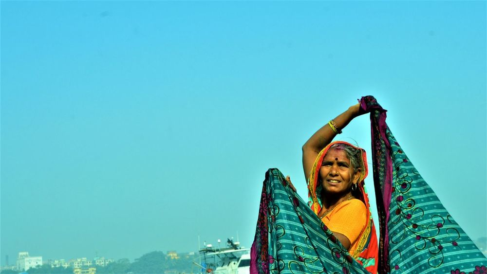 Held High! Mature Adult People Sky Clear Sky Blue Happiness Lifestyles One Person Women Saree Kolkata Ganga River Village Woman Smiling Day Outdoors