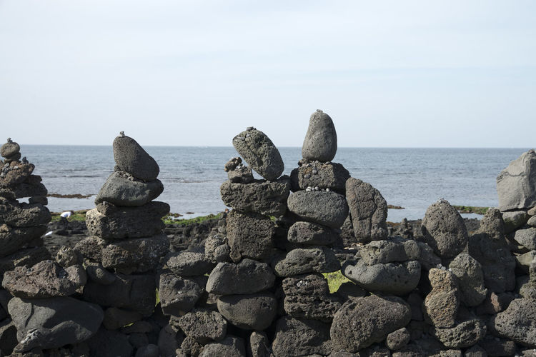 seaside view of stone stack at Gujwaup in Jeju Island, South Korea Beach Beauty In Nature Coastline Day Groyne Gujwaup Horizon Over Water JEJU ISLAND  Nature No People Outdoors Rock Rock - Object Rock Beach Scenics Sea Seaside Sky Stone Stack Tranquil Scene Tranquility Water