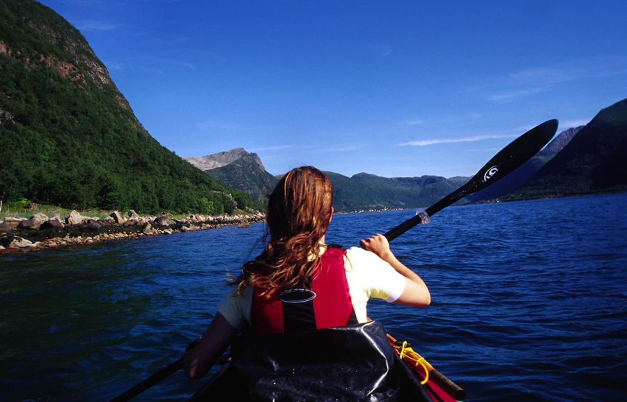 Adult Adventure Beauty In Nature Clear Sky Day Leisure Activity Lifestyles Mountain Nature Nautical Vessel Oar One Person Outdoors People Real People Rear View Rowing Scenics Sea Senja  Sky Transportation Vacations Water Women Be. Ready. An Eye For Travel