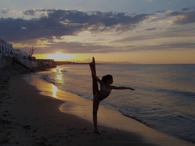 Sunset Beach Sea Sun Silhouette Exercising Lifestyles Beauty In Nature Sand Flexibility Horizon Over Water Sunlight