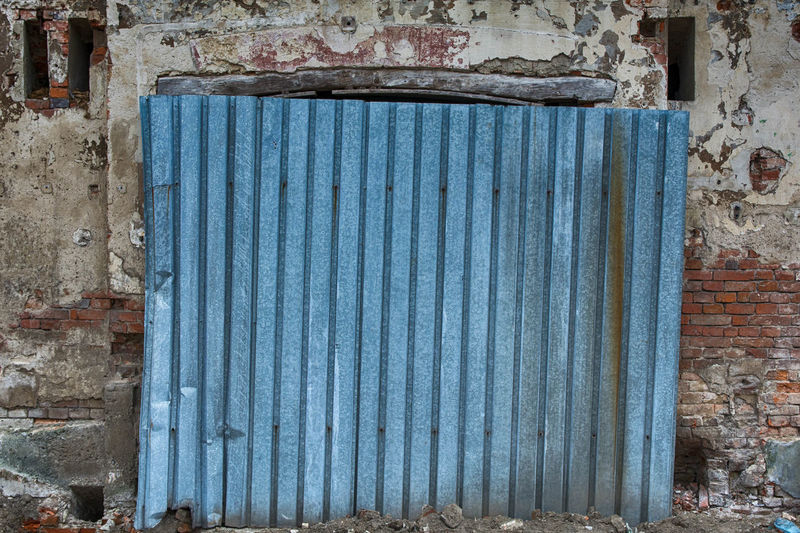 Architecture Wall - Building Feature Built Structure Metal Old Blue Weathered Building Exterior Day No People Closed Wall Abandoned Corrugated Iron Damaged Building Protection Security Run-down Decline Deterioration Iron Corrugated Ruined