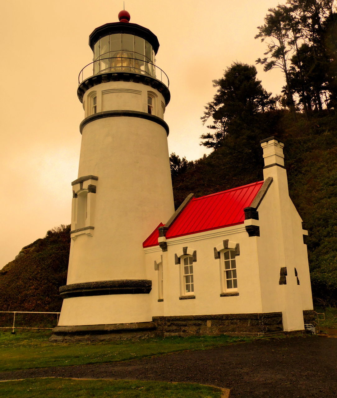 architecture, building exterior, built structure, lighthouse, tree, no people, sky, guidance, outdoors, sunset, low angle view, day, grass, nature