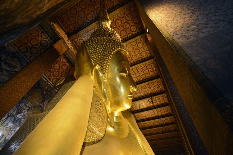 Low angle view of golden buddha statue in temple