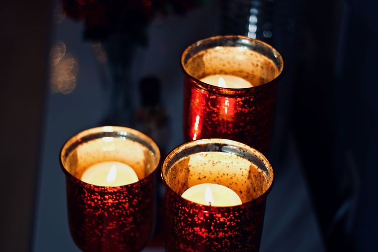 Close-Up Of Tea Light Candles On Table