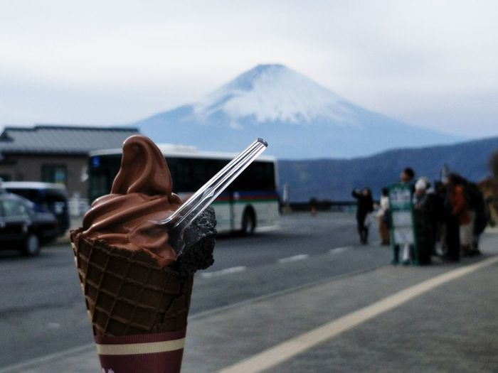 Close-up of ice cream against snowcapped mountain