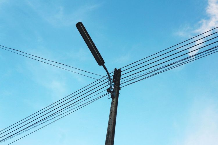 Low Angle View Cable Connection Power Line  Power Supply Sky Electricity  Day No People Fuel And Power Generation Electricity Pylon Technology Cloud - Sky Outdoors Nature