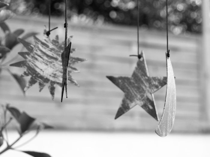 Four shapes suspended in BnW Good Luck Charms Decoration Stars Star Turning Shapes Sun Moon Outdoor Black And White Black And White Photography