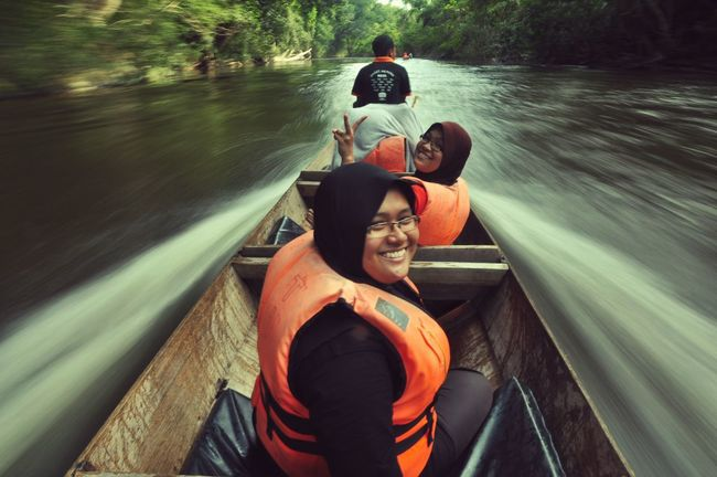 Me with my two sisters & brother went for a long boat ride to Lata joyous moment was captured by my younger brother who sat behind ride took 45mins and they both looked so was one of our great outdoor activity together in Kuala Tahan National Park, Pahang, Family bonding was there. Great Outdoors - 2018 Eyeem Awards Siblings Long Boat Ride Kuala Tahan National Park Water Photography Themes Smiling Togetherness Men Portrait Women Boat The Great Outdoors - 2018 EyeEm Awards