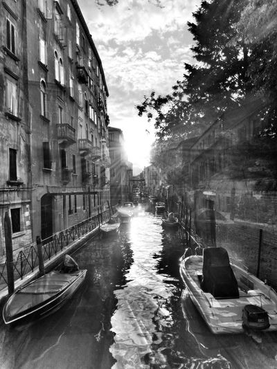 A double exposure Building Exterior Architecture Canal City Tree Transportation Built Structure Outdoors Day Sky No People Water Gondola - Traditional Boat Boat Heimat Amazing Double Exposure Venice Canals B&w Blackandwhite Stunning Powerful Light Sun Sunray The Architect - 2017 EyeEm Awards Black And White Friday