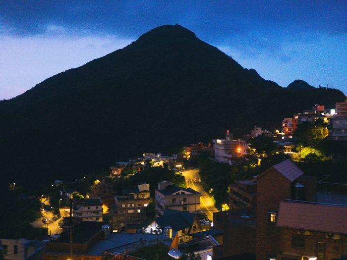 View of illuminated town at night