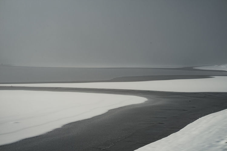 Scenic view of land against sky during winter