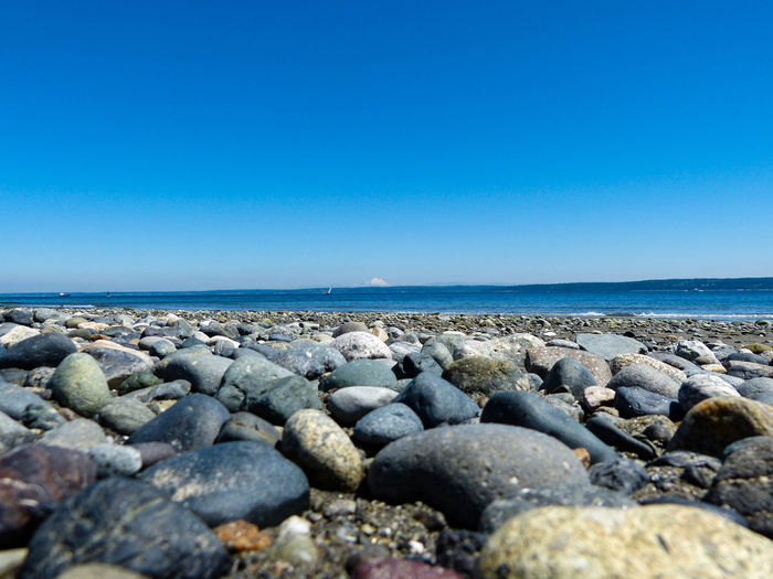 Beach Beach Photography Beauty In Nature Blue Calm Clear Sky Day Horizon Over Water Idyllic Mt. Baker Outdoors Pebble Puget Sound Rock Rock - Object Scenics Sea Shore Sky Stone Stone - Object Surface Level Tranquil Scene Tranquility Water