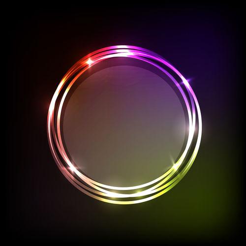 Close-up of illuminated light over black background