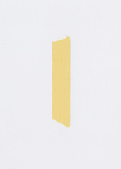 High angle view of yellow paper against white background