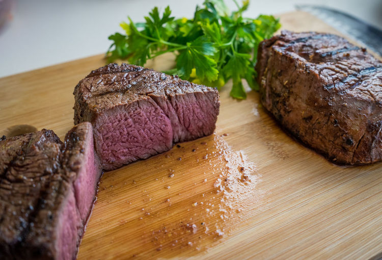 Beef Brown Close-up Cutting Board Dinner Focus On Foreground Food Food And Drink Freshness Indoors  Indulgence Meat No People Ready-to-eat Red Meat Serving Size Steak Still Life Table Temptation Unhealthy Eating Wood - Material