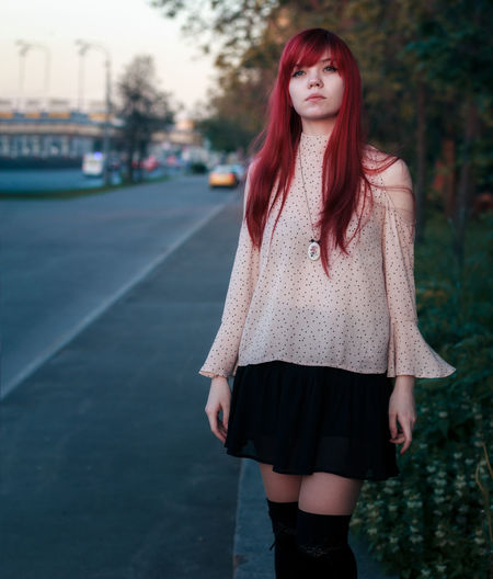 Beautiful Young Woman Standing On Street