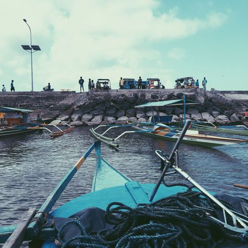Water Sea Day Nautical Vessel Sky Outdoors Built Structure Building Exterior Architecture Waterfront Cloud - Sky Transportation Beach Travel Destinations Moored People In The Background Nature Horizon Over Water No People Harbor