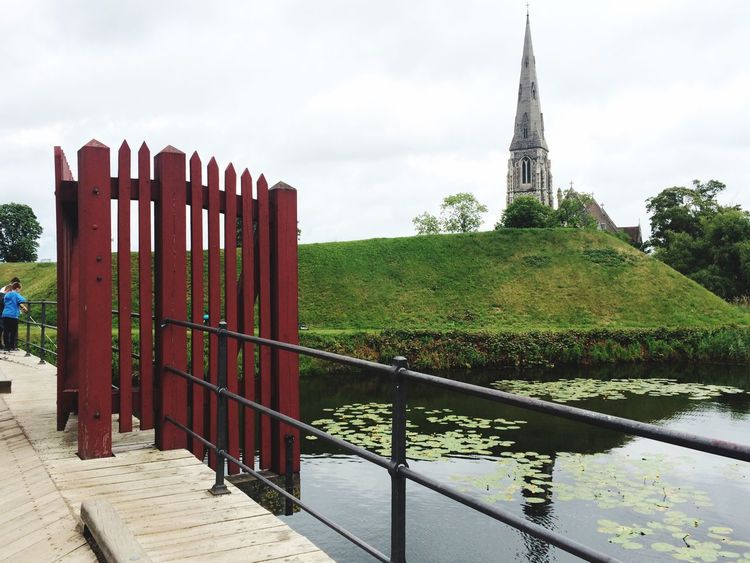 Railing Sky Architecture Built Structure Day No People Outdoors Building Exterior Nature Tree Grass Water Copenhagen Kastellet Denmark Landscape Beauty In Nature
