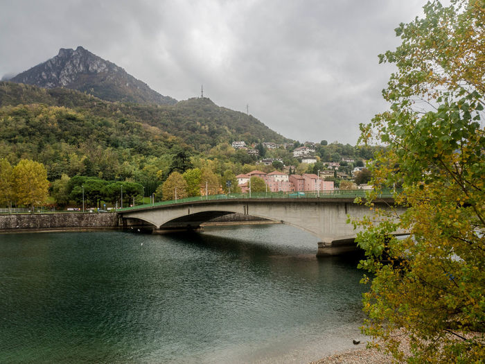 Water Built Structure Connection Bridge Architecture Mountain Bridge - Man Made Structure Sky River Tree Plant Nature No People Cloud - Sky Day Transportation Beauty In Nature Outdoors Arch Bridge Como Como Lake Alps Italy