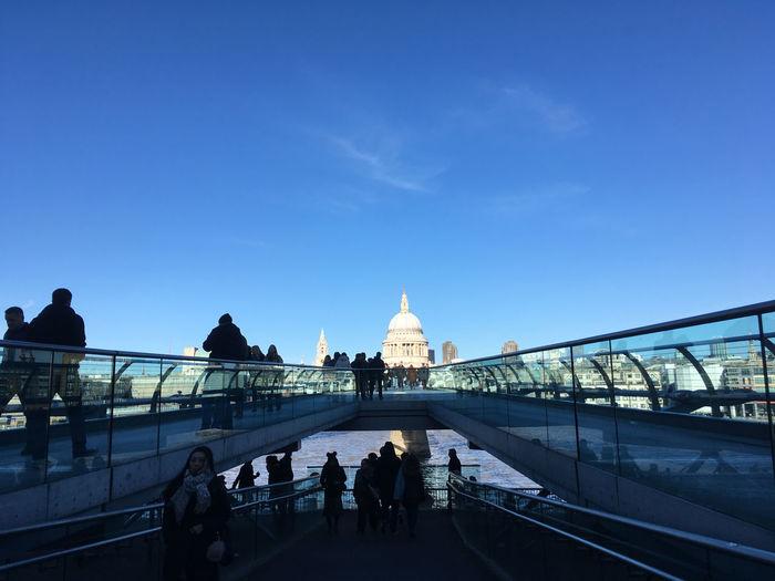 People on millennium footbridge in city