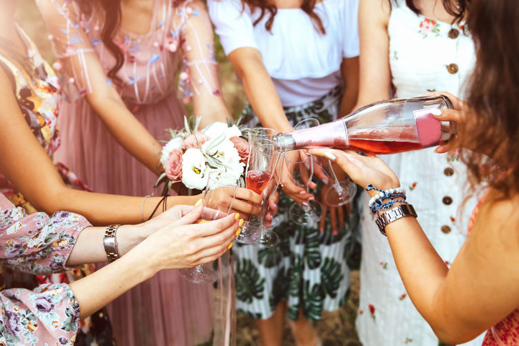 Women Group Of People Celebration Holding Flower Flowering Plant Event Real People Adult Alcohol Midsection Lifestyles Friendship Drink Togetherness Refreshment Glass Emotion Plant Medium Group Of People Celebratory Toast Hand Drinking Positive Emotion