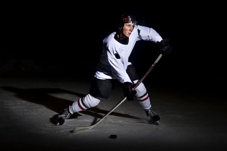 Full length of man playing ice hockey