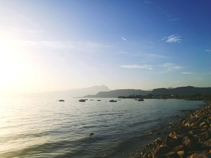 Sea Water Tranquility Beach Tranquil Scene No People Outdoors Horizon Over Water Nature Sunset Sunlight Sun Scenics Beauty In Nature Travel Destinations Landscape Sky Silhouette Mountain Day