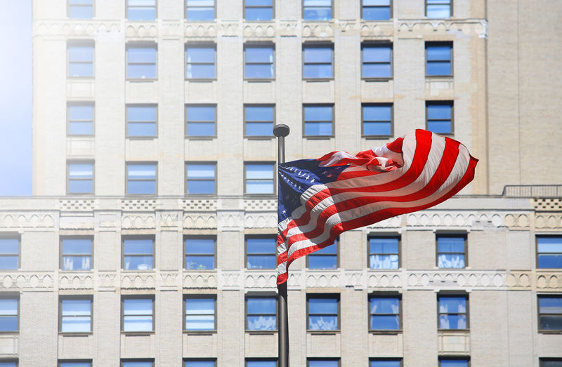 Independence Day American Flag America USA Architecture Building City Building Exterior Low Angle View Patriotism Built Structure Striped Waving