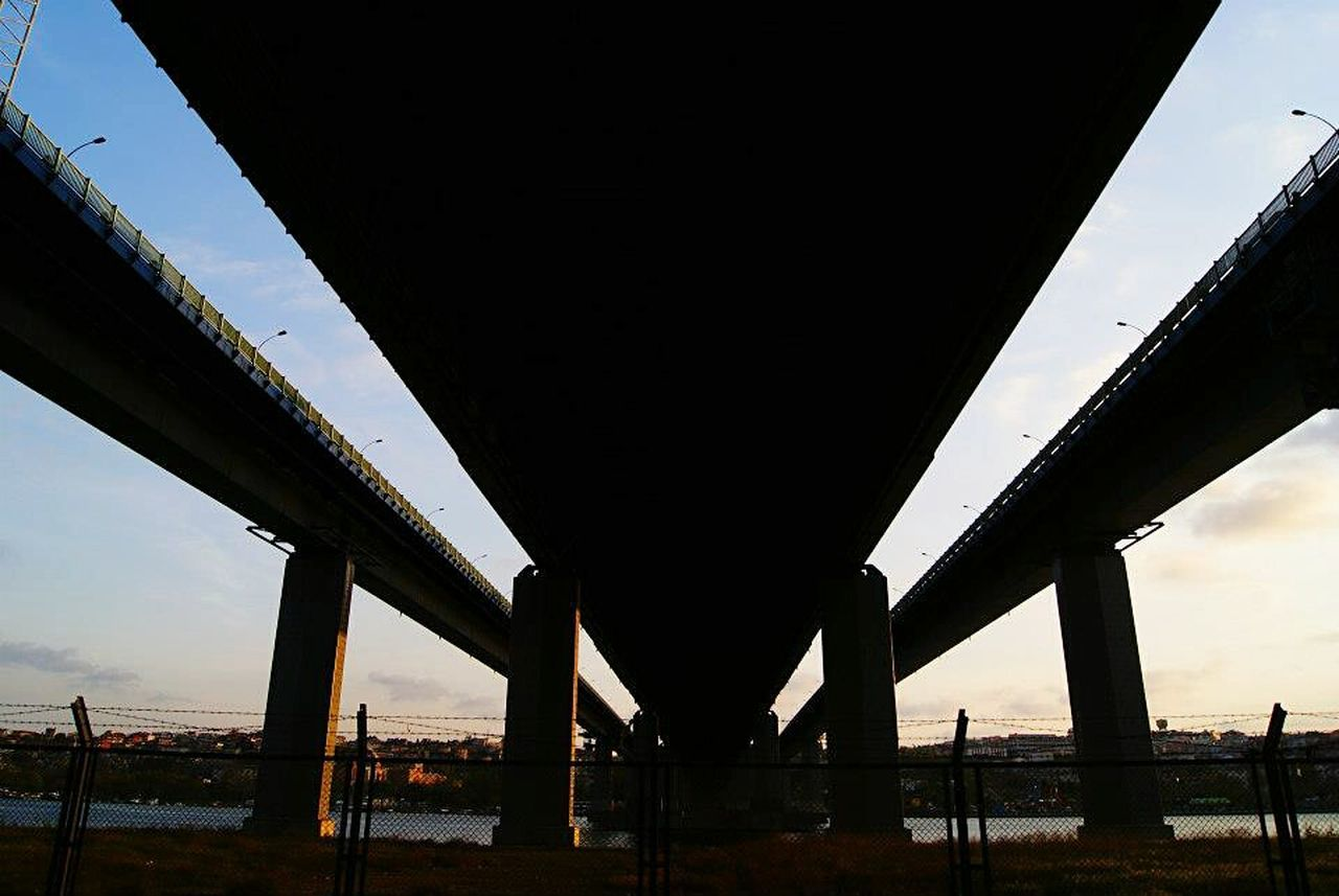 bridge - man made structure, connection, below, underneath, built structure, architecture, transportation, architectural column, low angle view, sky, outdoors, no people, under, day, nature