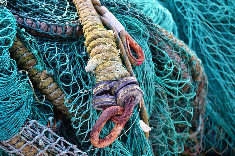 Full Frame Shot Of Fishing Nets At Harbor