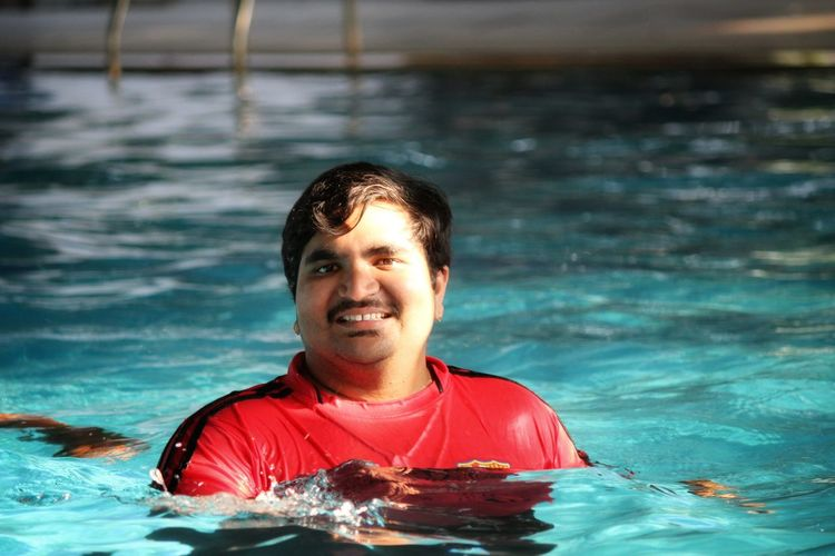 Smile in blue water Swimming Blue Water Smile UnderSea Swimming Pool Sportsman Portrait Underwater Adventure Men Red