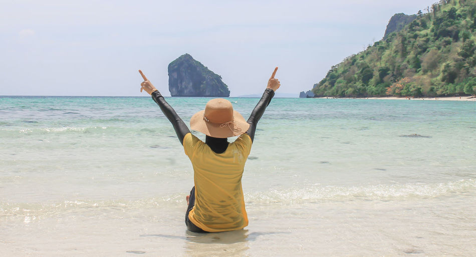 1 Girl Krabi Thailand Arms Raised Beach Beauty In Nature Casual Clothing Day Horizon Over Water Human Arm Land Leisure Activity Lifestyles Nature Non-urban Scene One Person Outdoors Real People Rear View Scenics - Nature Sea Sky Water