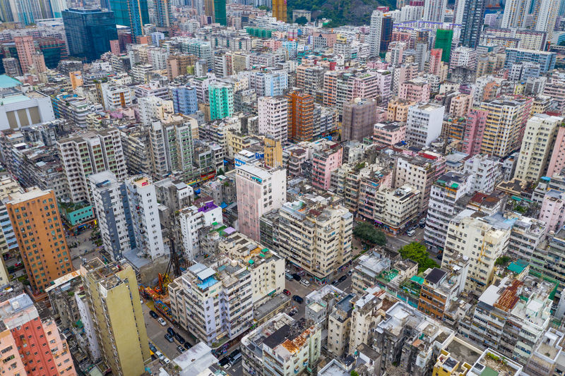 Top view of Hong Kong city Business Urban Hong Kong Top View City Sham Shui Po Kowloon Side District Compact Residential  Downtown Mong Kok Building Street Skyline Architecture Cityscape Wide Travel Day Landmark Traffic Skyscraper Tower Aerial Fly Drone  Over Above Down Top Down Bird Eye Hk Hong Kong